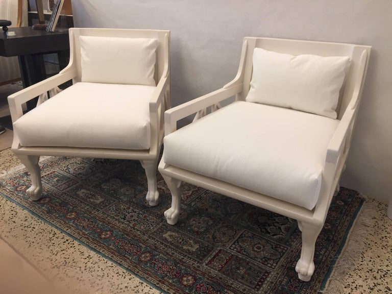 This is a phenomenal and rare pair of John Hutton chairs, beautifully refinished and reupholstered.  Designer John Hutton was a San Francisco designer, Who virtually created a genre of modern furniture. He came into his own after he became the