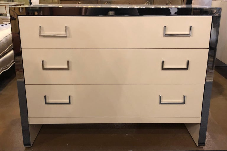 Pair of spectacular Mid-Century Modern recently refinished John Stuartlabeled white lacquer and chrome accented chests, commodes, dressers or nightstands. These stunning Milo Baughman Designed pair of chests by the Highly Sort After Designer, John