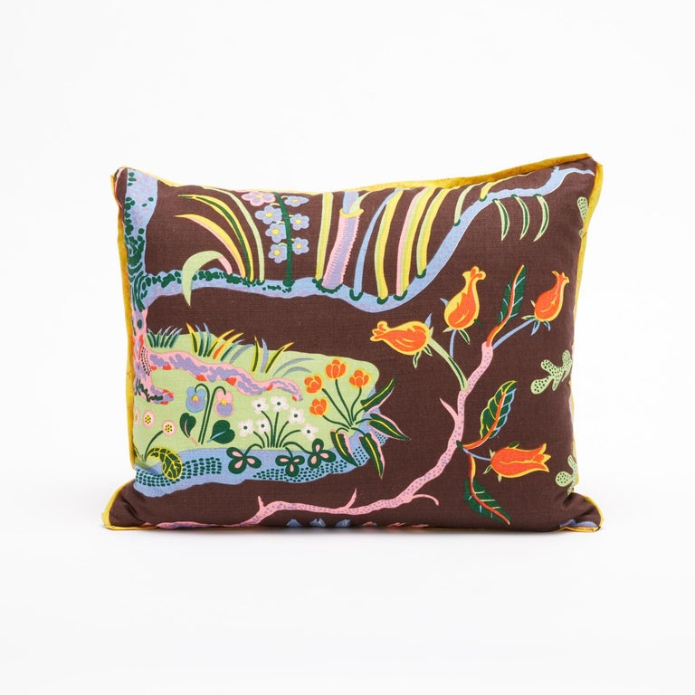 A set of two rectangular cushions featuring vintage fabric by Austrian designer Josef Frank. Each cushion displays a design motif from Josef Frank's