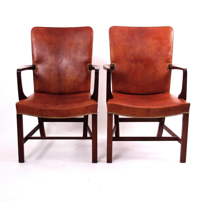 Kaare Klint & Rud Rasmussen, Mid-Century Modern Design  A magnificent pair of Kaare Klint 'Nørrevold' armchairs in patinated Nigerian leather, model no. 5999. This is the largest chair in the series of