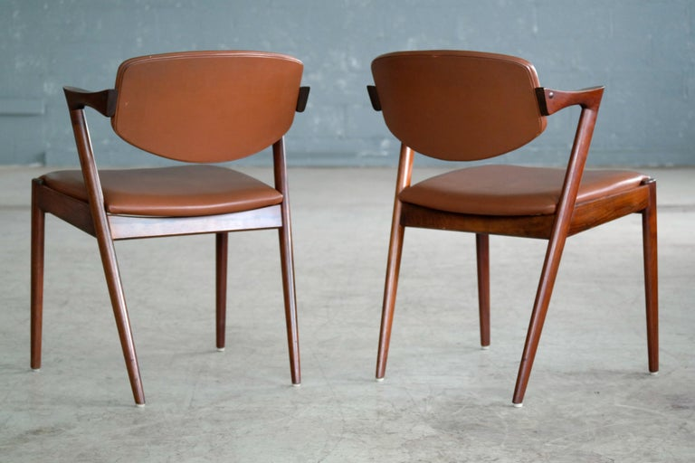 Pair of model #42 dining chairs also known as the