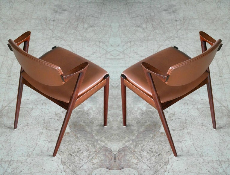 Mid-Century Modern Pair of Kai Kristiansen Model 42 Rosewood Dining Chairs and Brown Leather