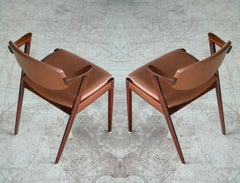 Pair of Kai Kristiansen Model 42 Rosewood Dining Chairs and Brown Leather