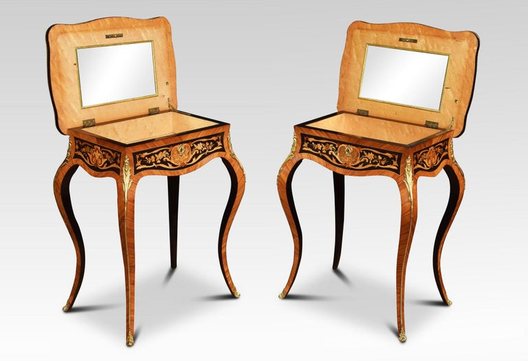 Pair of kingwood side tables the floral marquetry scrolling inlaid tops having brass rim enclosing storage compartment with mirrored lid all raised up on slender cabriole brass-mounted supports. Dimensions: Height 29.5 inches Length 23.5