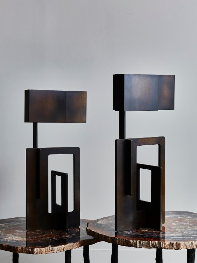 Pair of sculptural and geometric table lamps designed and made by Esperia in waxed iron finish with matching shades.