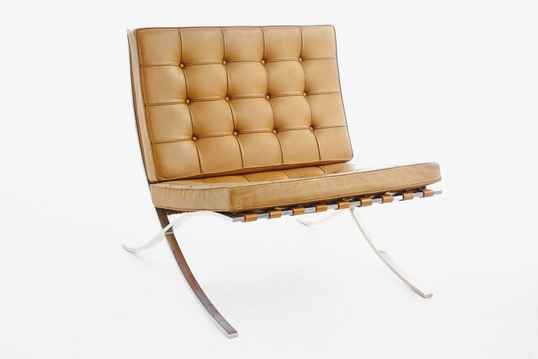 Stunning pair of Barcelona chairs manufactured by Knoll, 1960s designed by Mies van der Rohe, Classic design, original hand-sewn tan leather seat and back cushions, wonderful patina, retain original early Knoll Associates label.Hand delivery avail