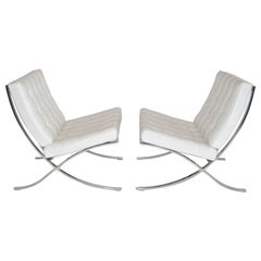 Pair of Knoll Barcelona Lounge Chairs in White Sabrina Leather Circa 2000s