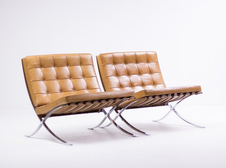Exceptional split frame pair of Barcelona chairs by Mies Van der Rohe for Knoll International in the most desirable cognac leather.