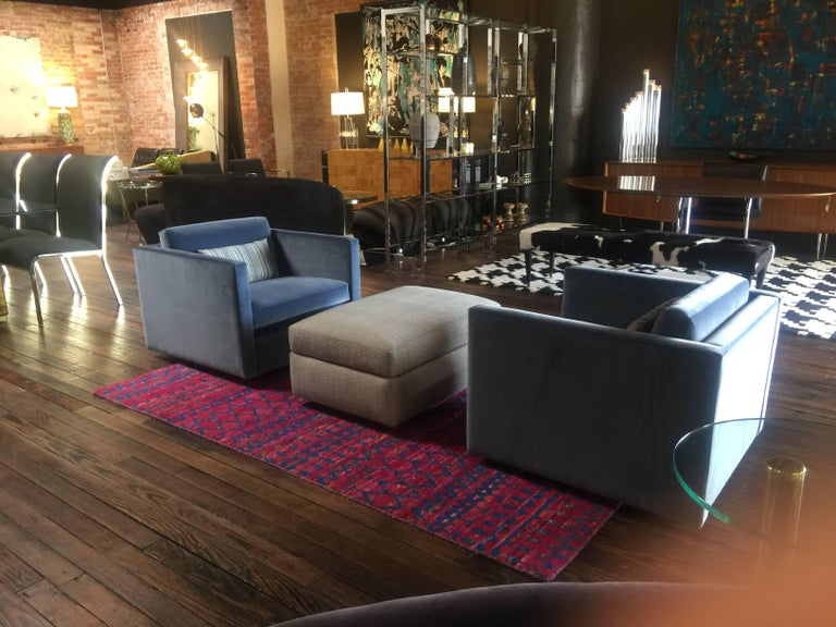 Knoll Lounge Chairs by Charles Pfister newly upholstered in blue velvet. A ottoman is upholstered in Holly Hunt fabric.  Ottoman is 33