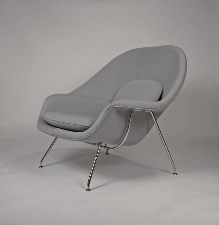 Very clean pair of womb chairs designed by Eero Saarinen and produced by Knoll. Retains paper label to underside. $3400 each. Original grey upholstery.