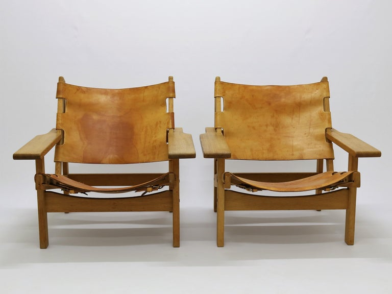Hunting chairs in oak and patinated saddle leather manufactured at KP-møbler (KP-furniture) in the 1960s. Danish designer Kurt Østervig. All original condition.