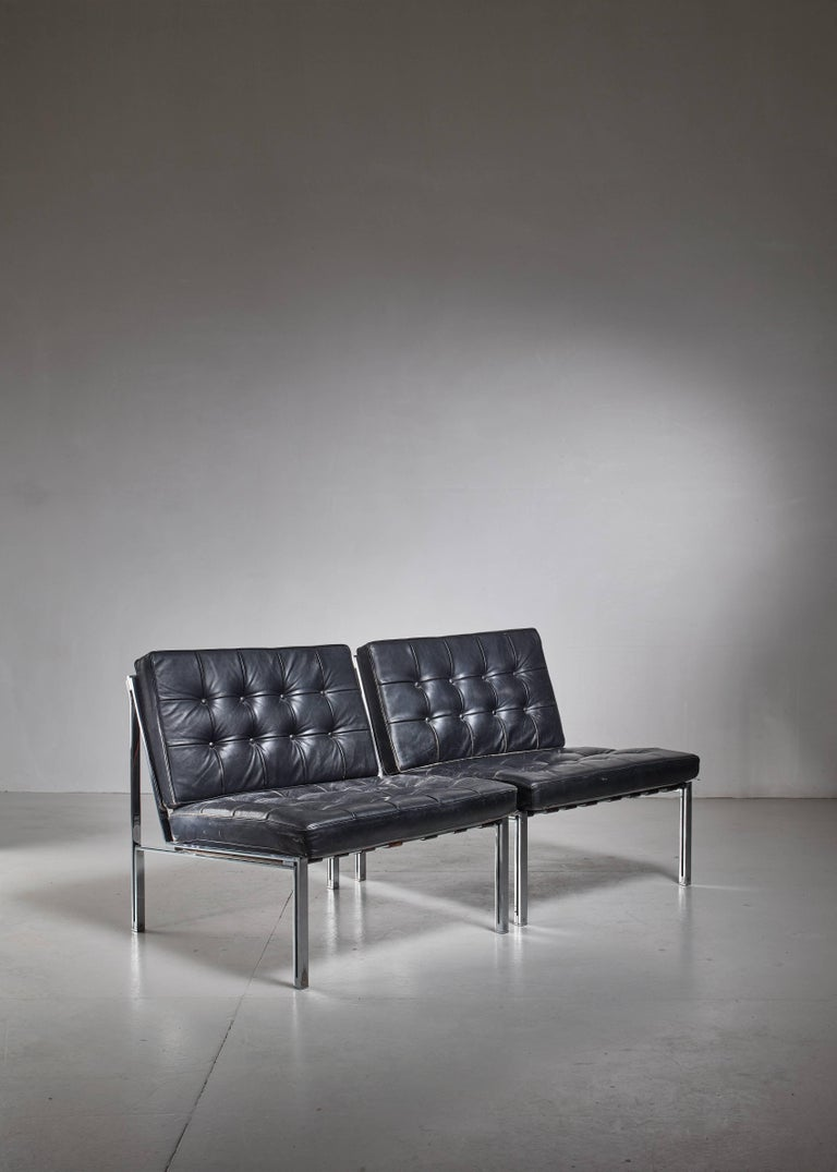 A pair of wonderful and luxurious KT 221 easy chairs by Swiss designer Kurt Thut. The chairs are made of a chrome-plated steel frame with tufted leather cushions, supported by leather straps. Excellent condition.