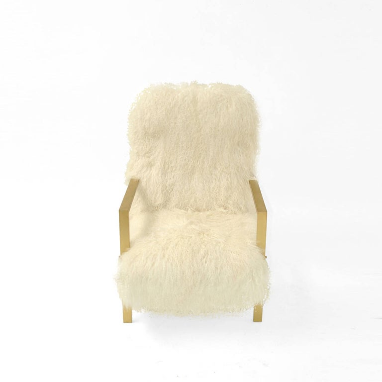 Comfortable armchairs designed by the creative team L.A. Studio and manufactured in Italy. Upholstered in natural white Mongolian goat´s fur. Base made of solid wood, arms and legs are made of rectangular solid brass tube that continuous as a