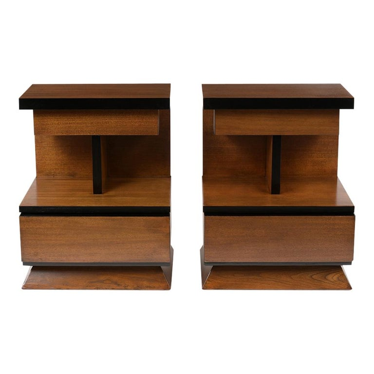 This pair of midcentury style nightstands have been restored and is newly refinished in a walnut and black color combination with a lacquered finish. These symmetric design nightstands come with a small top drawer, in the center has an open shelf
