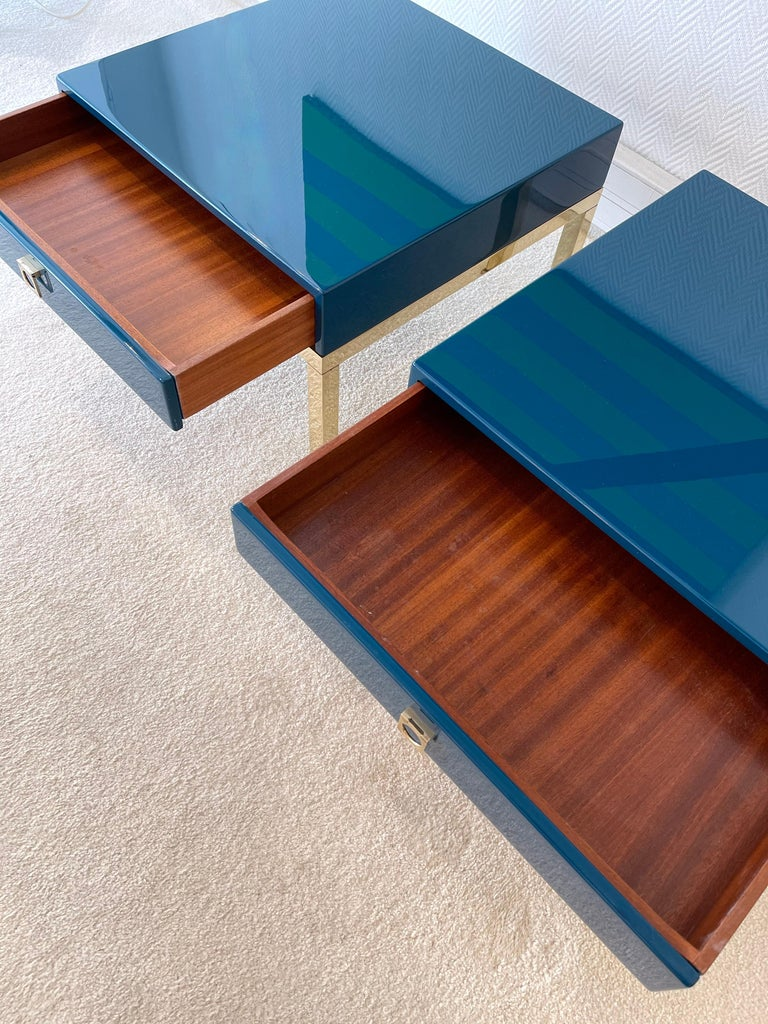 Pair of blue lacquered and brass feet side end low tables or nightstands by Guy Lefèvre. A part of his production was retail by the Maison Jansen in Paris during the 1970s.