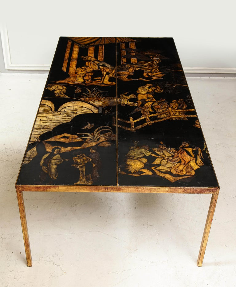 Exceptional hand-lacquered chinoiserie coffee table on gilt-iron base - tabletop depicting Asian characters and scenery - all hand carved. Price for one table. Additional table available.
