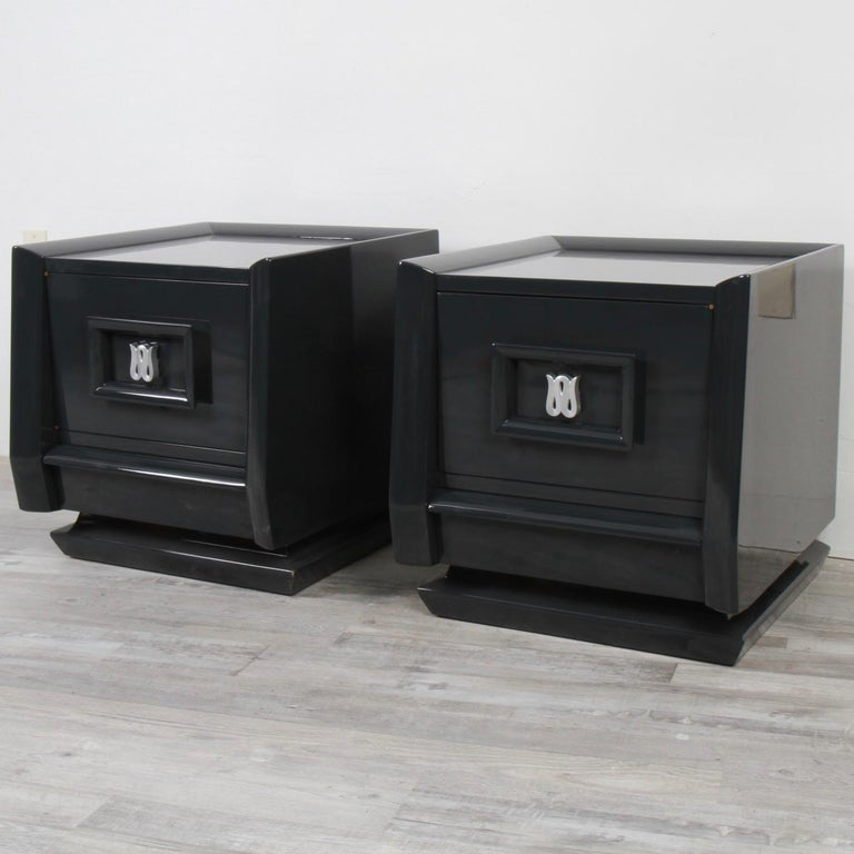Design wise these were nice in their original blonde mahogany, but they look even better in their new graphite grey lacquer. Made in the early 60s by Carlton House furniture, these nightstands feature a single drawer cabinet with a lower drawer.
