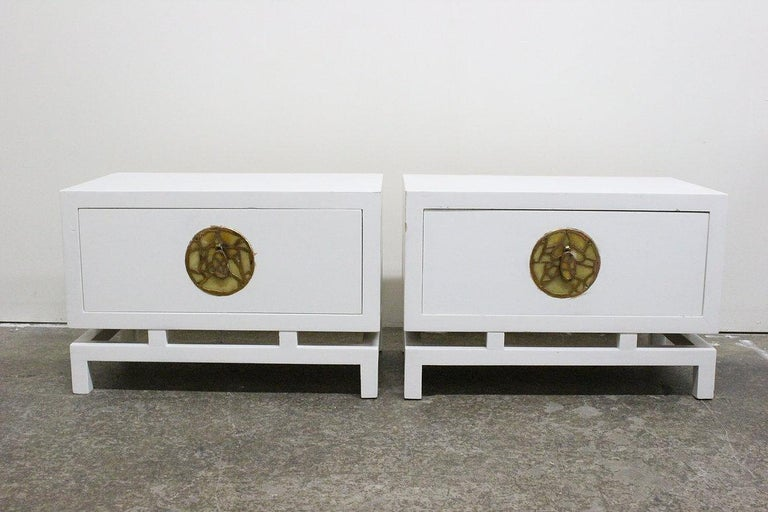 Pair of lacquered nightstands / side tables by Frank Kyle with hardware by Pepe Mendoza. There is visible wear from age and use and refinishing is recommended.  Dimensions:  27