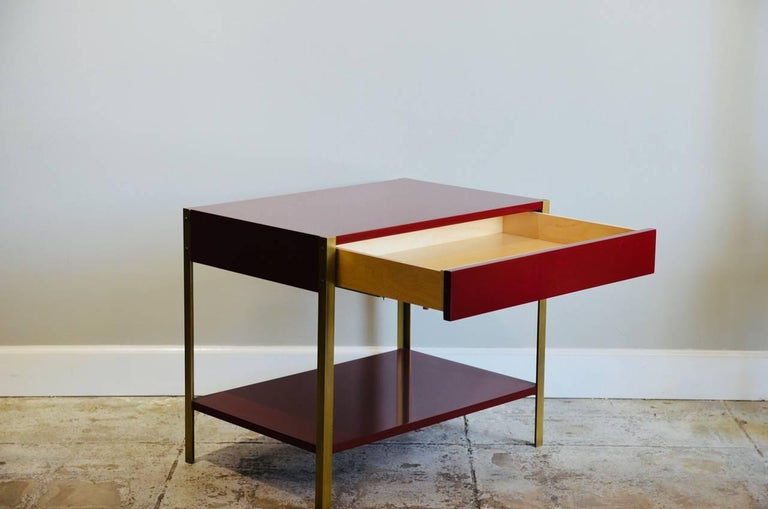 French Pair of 'Laque' Oxblood Lacquer and Brass Nightstands by Design Frères For Sale