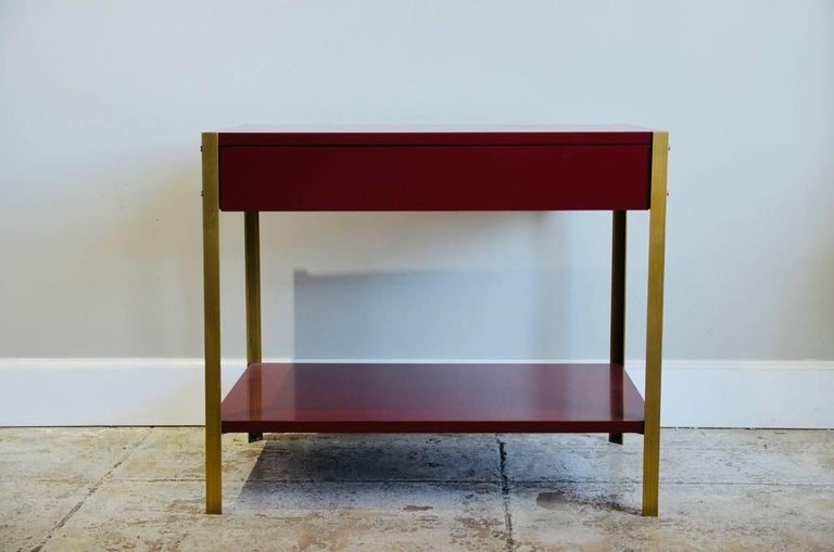 Lacquered Pair of 'Laque' Oxblood Lacquer and Brass Nightstands by Design Frères For Sale