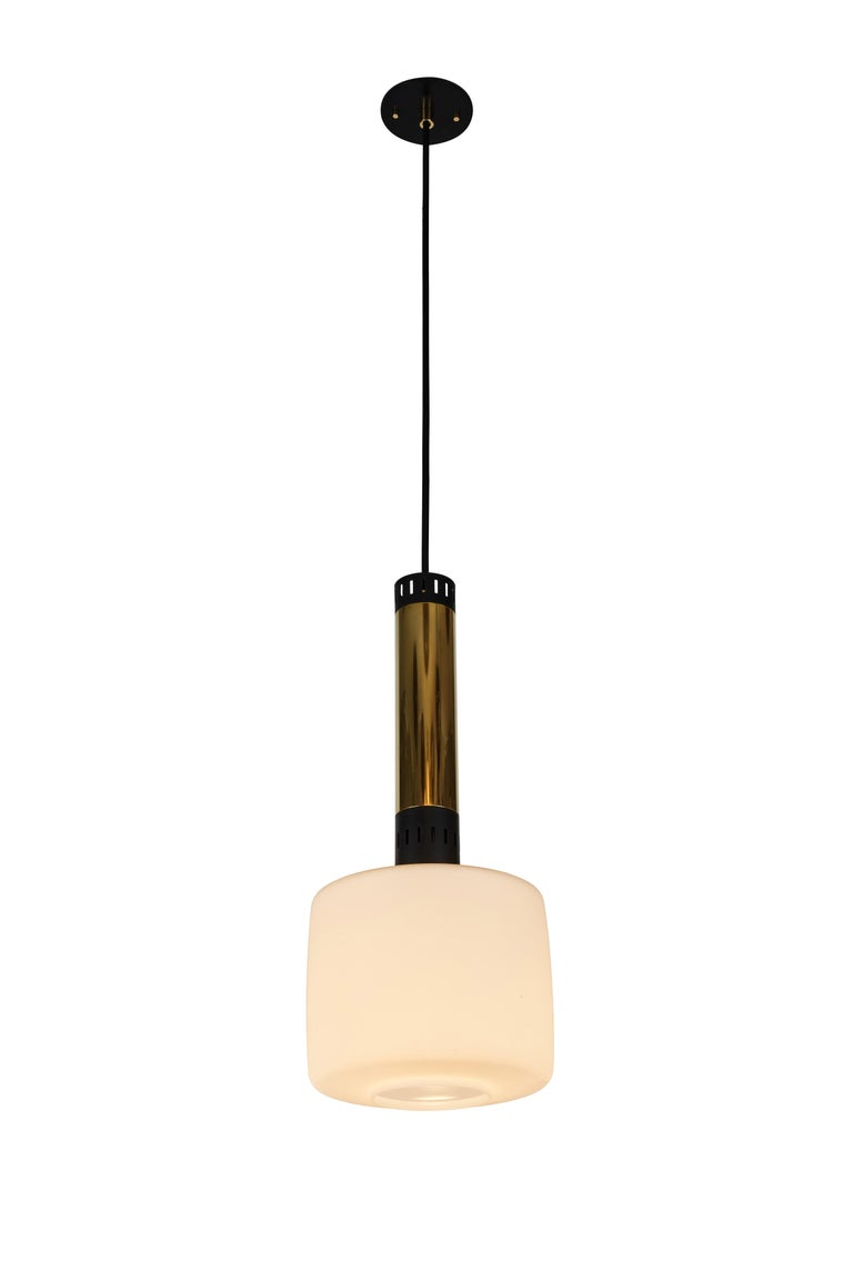 Pair of large 1950s Stilnovo glass and brass pendants. A quintessentially 1950s Italian design executed in matte finish opaline glass and polished brass with a custom fabricated architectural ceiling canopy for mounting over a standard American