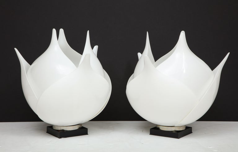 A stunning large pair of 1980s acrylic lamps by Rougier. The lamps have 6 large petals which resemble Artichoke leaves and they have been newly rewired. There are a couple of minimal repairs which are not noticeable on the inner petal.