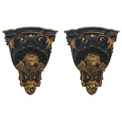 Pair of Large 19th Century Carved and Parcel Gilt Cherub Wall Brackets