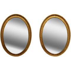 Pair of Large 19th Century French Giltwood Carved Oval Shaped Mirrors