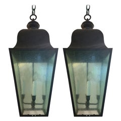 Pair of Large 20th Century Black Iron Four-Light Lanterns with Tinted Glass