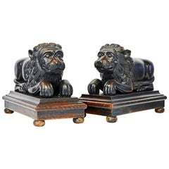 Pair of Large Anglo-Indian Carved Lions Couchant on Molded Bases, circa 1920