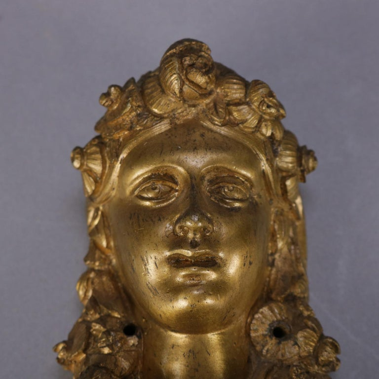 A pair of oversized French Louis XV style architectural mounts feature cast ormolu construction with female masks surmounting foliate elements, 19th century  Measures: 12