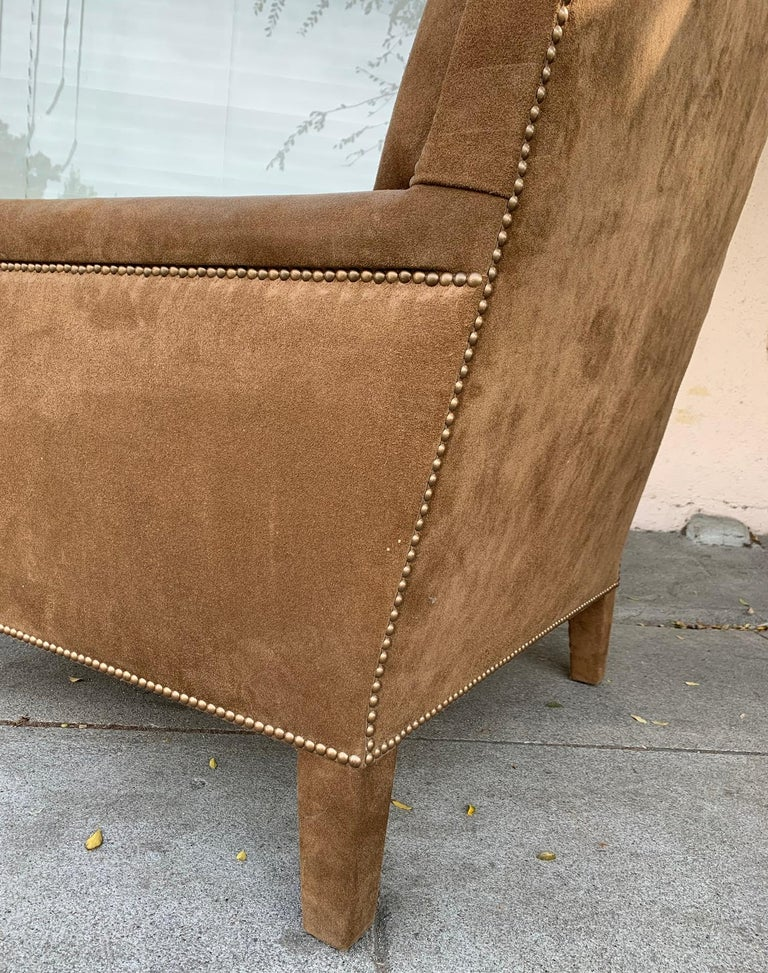 """Pair of large armchairs upholstered in brown suede with nailhead trimming. The chairs are in excellent condition, vintage but newly upholstered. Measurements: 37"""" high x 32"""" wide x 39"""" deep x 20"""" seat height x 25"""" seat depth x 25"""" seat width x"""
