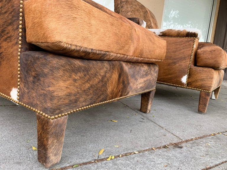 Pair of Large Armchairs Upholstered in Cowhide Leather In Good Condition For Sale In Los Angeles, CA