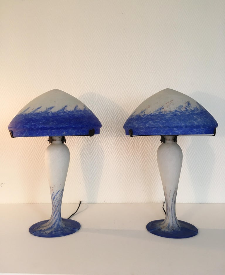 Stunning table lamps by Art de France. They were manufactured in France and feature blue, white and even some red colors. They remain in very good condition. Pieces will be carefully packed and send insured.