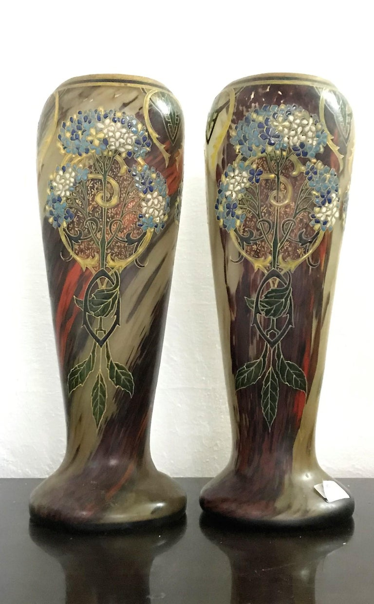 Pair of large Art Nouveau hand blown and hand enameled glass by François Theodore Legras in France, circa. 1890. Decorated in a clear Art Nouveau style, both vases present three sides with Trellises, flowers and stylised scroll work. Both Vases