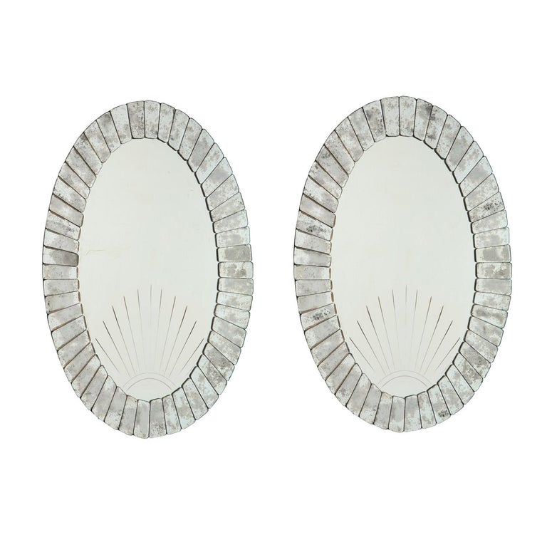 Pair of superb large artisan etched Art Deco sunset mirrors with antiqued mirror starburst pattern around center mirror, Venetian 1930's. The Venetians did many tributes to the spectacular sunsets over the lagoons. This is a beautifully crafted pair