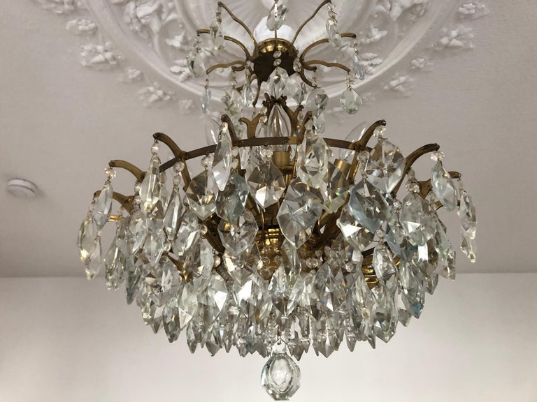 Mid-Century Modern Pair of Large Austrian Crystal and Brass Chandeliers, circa 1960s For Sale