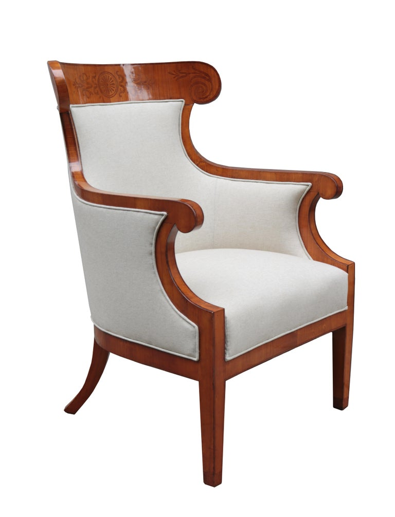 A fine pair of large Biedermeier armchairs. Walnut with fruitwood inlays.