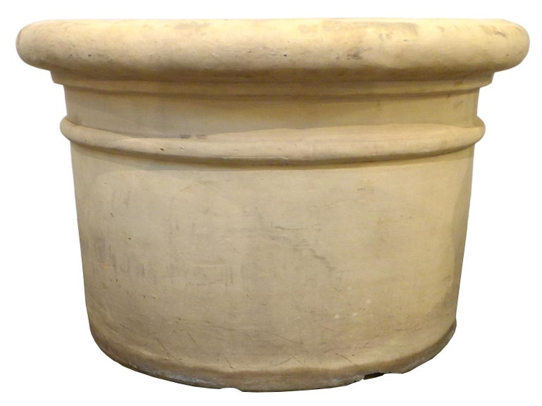 An exceptional matched pair of large bisque-finish terracotta planters made by Italia Terra Cotta Company in Los Angeles, California, circa 1930. Simple, elegant forms with great scale and a wonderfully muted, raw-bisque tone. Great decorative