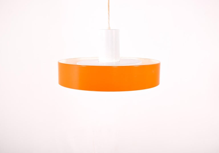 Stunning pair of 1960s-era 'Blågård' ceiling light designed by Karen and Ebbe Clemmensson and Jorgen Bo for Fog & Mørup. Lamp is constructed from metal with an orange and white finish. Produced in Denmark.