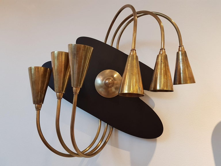Pair of Large brass, Italian, Mid-Century Modern wall sconces, attributed to Stilnovo, with a painter's palette shape.