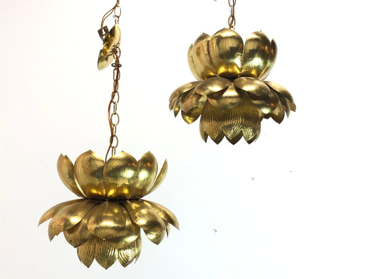 Pair of large brass lotus pendants. Pendants are in good vintage condition with visible oxidation of brass. Original wiring.  Dimensions: 16.5