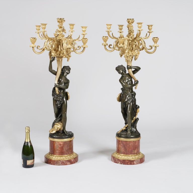 French Pair of Large Bronze Candelabra after the Model by Clodion on Marble Bases For Sale