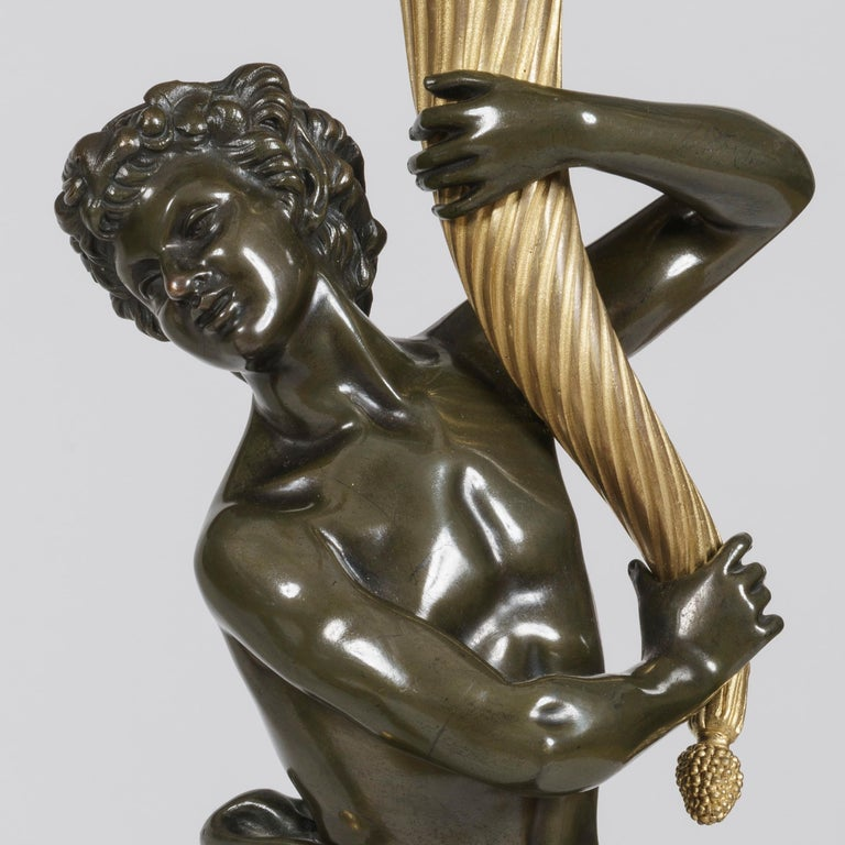 Gilt Pair of Large Bronze Candelabra after the Model by Clodion on Marble Bases For Sale
