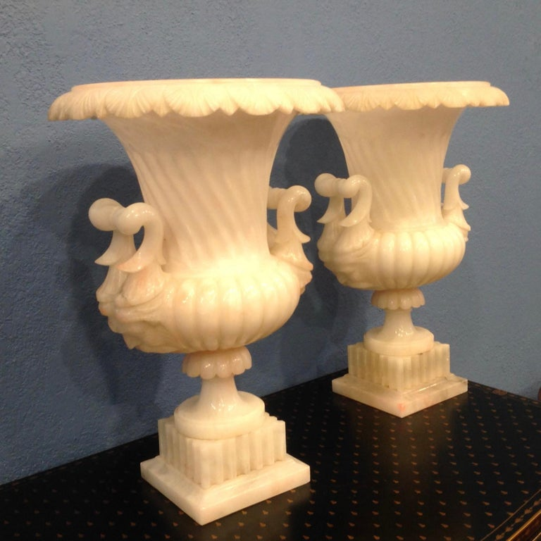 Sensational quality and design. The urns are fluted and ribbed; and the handles are appointed with faces.