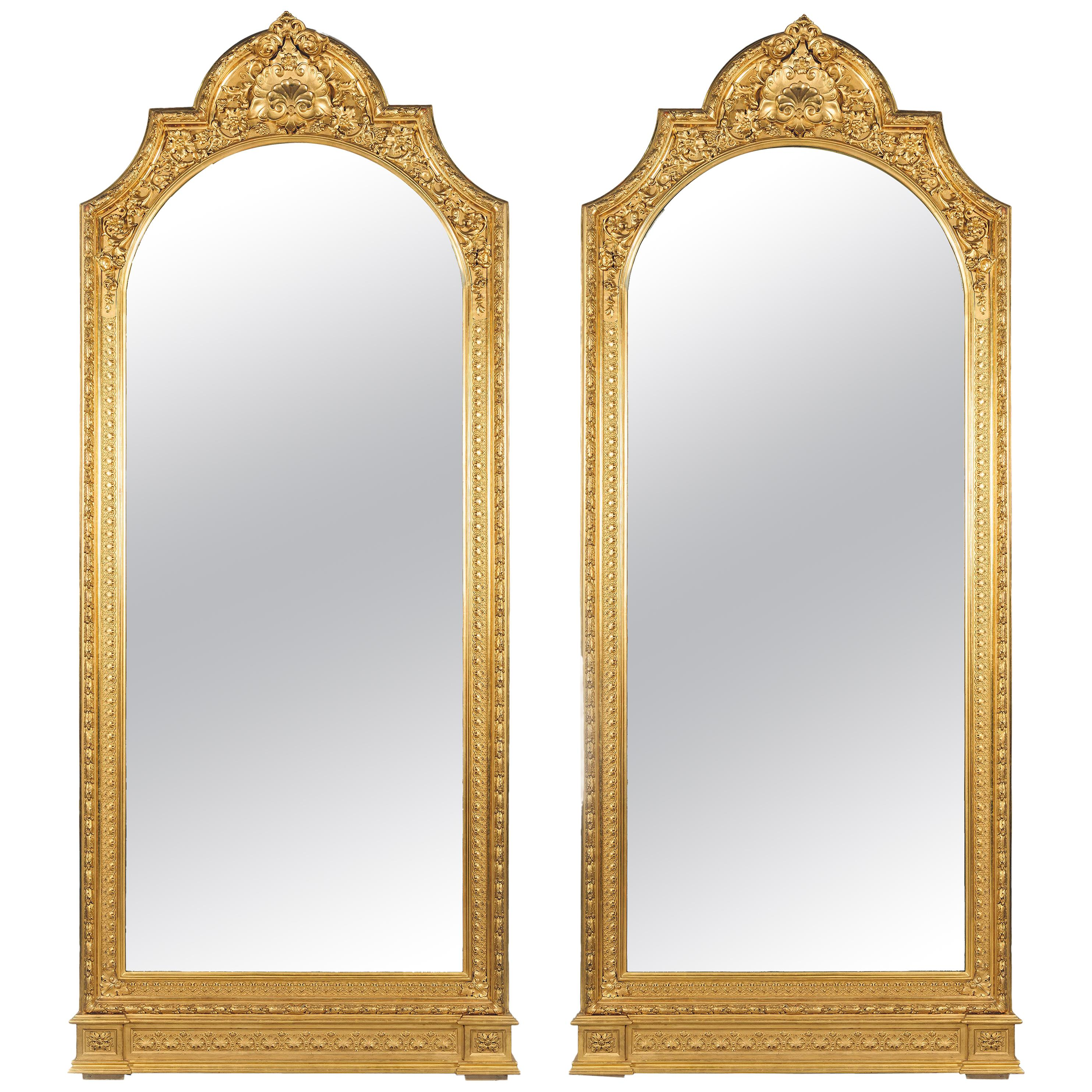 Pair of Large Carved Giltwood and Gesso Mirrors