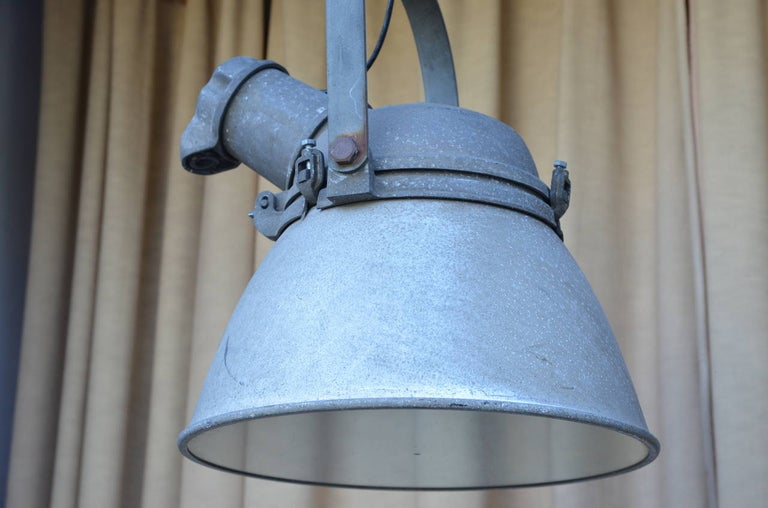 Pair of Large Cast Iron, Aluminum and Glass Industrial Hanging Lights In Good Condition For Sale In Los Angeles, CA