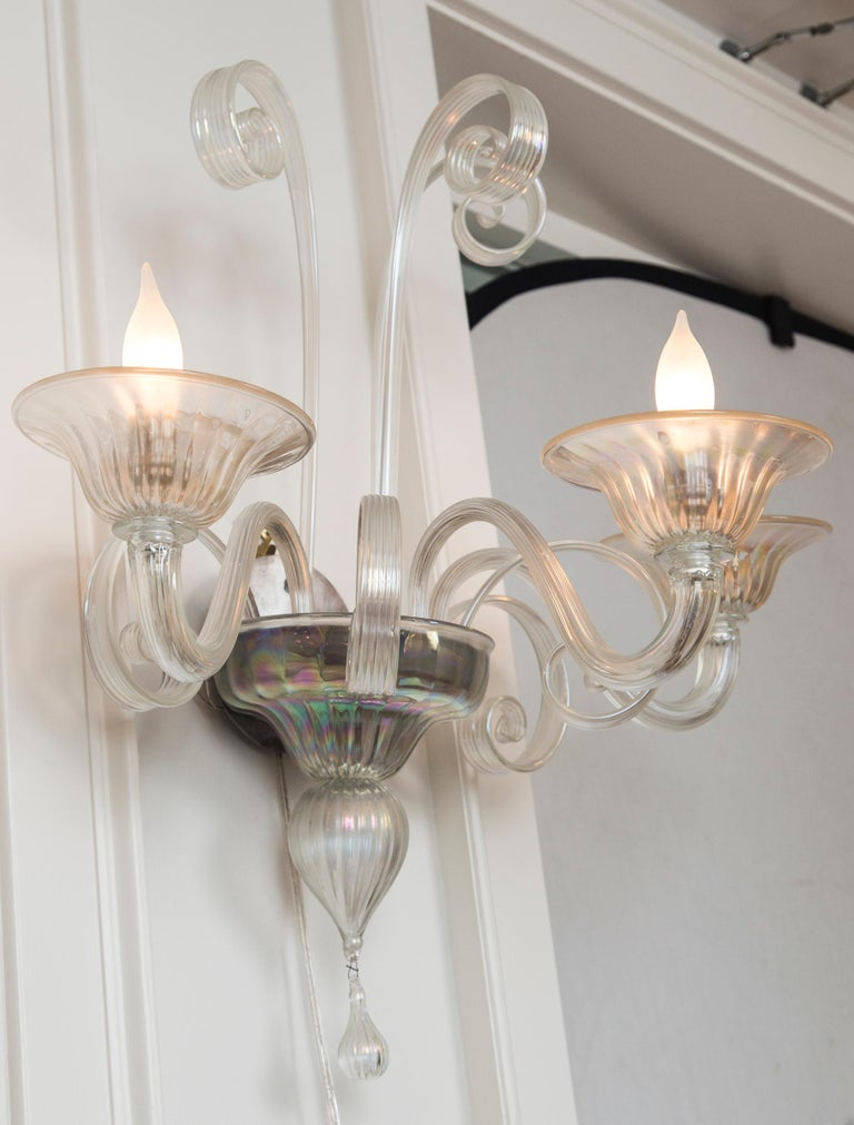 Large pair of iridescent blown three light sconces with matte nickel sockets, newly electrified to code with new UL approved matte nickel sockets, not install ready. Minimal detailing with lovely reeded textured glass and soft swirling