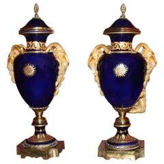 Pair of Large Cobalt Blue Lidded Urns with Gilt Rams Head Handles
