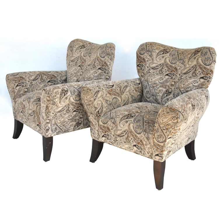 Pair of contemporary wing back chairs   Pair of over sized traditional style wing back chairs. Soft chenille in a paisley pattern.  Measures: 36